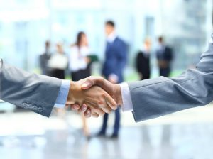 Due diligence-Mergers and Acquisitions- Deal made with a handshake in an office